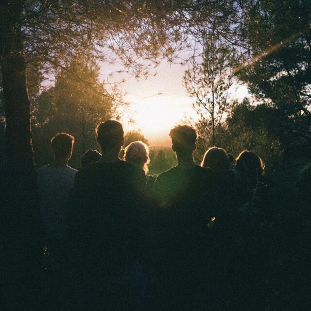 Group of people looking into the sunset