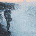 Man standing next to an ocean