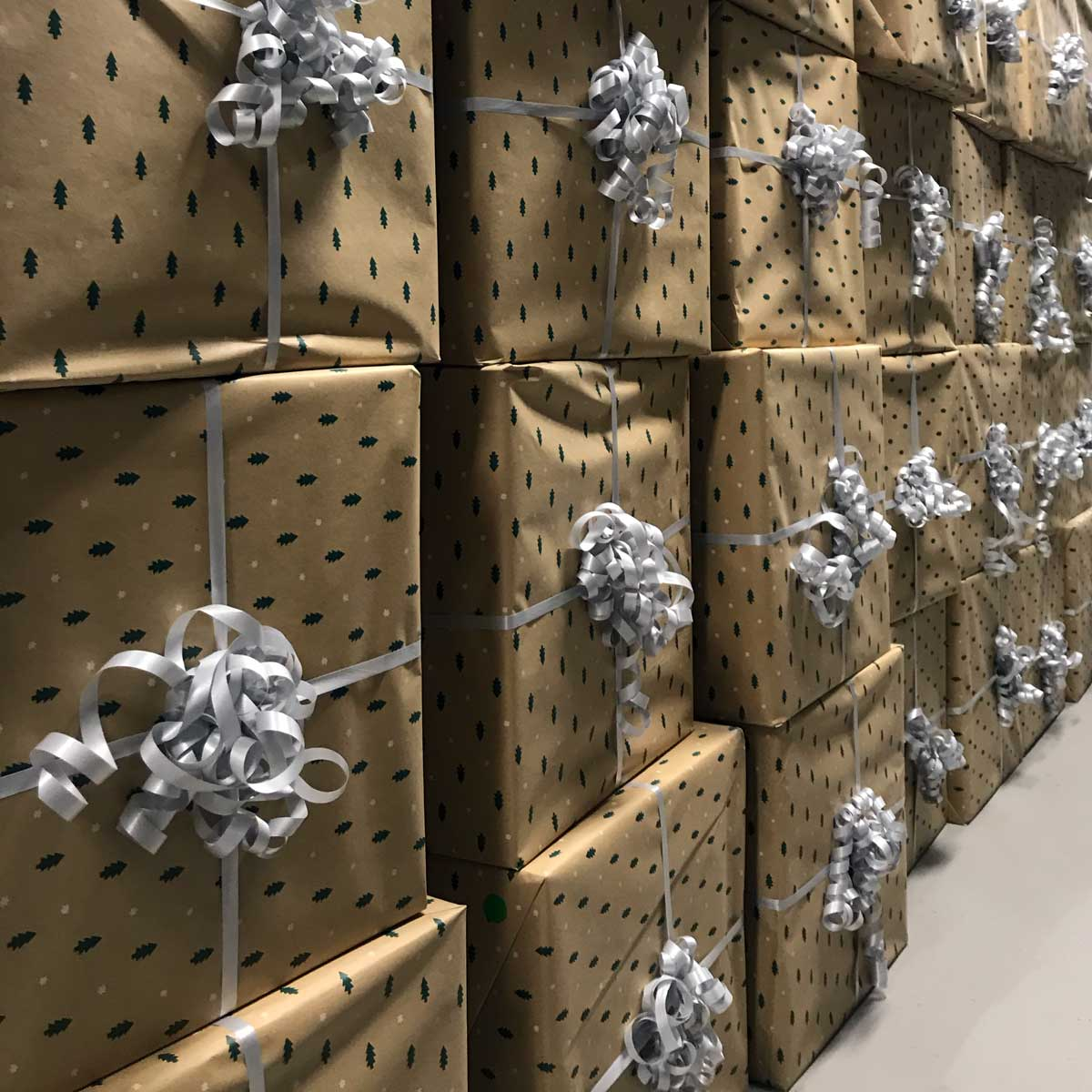 Kindred Group Christmas presents packed in golden boxes